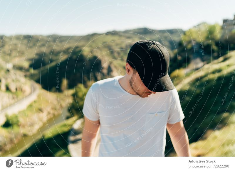 Cheerful man in mountains Man Mountain Cap Happy Youth (Young adults) Adventure Nature Healthy Vacation & Travel Human being Lifestyle Portrait photograph