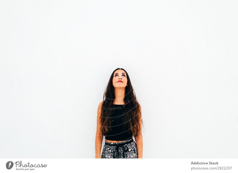 Young woman leaning on white wall Woman pretty Youth (Young adults) Beautiful Stand Lean White Wall (building) Brunette Attractive Human being