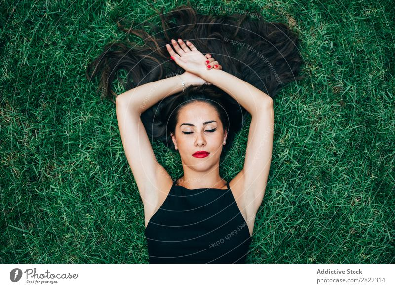 Cheerful brunette woman lying in grass Woman pretty Youth (Young adults) Beautiful Lie (Untruth) Grass Nature Brunette Attractive Human being Beauty Photography