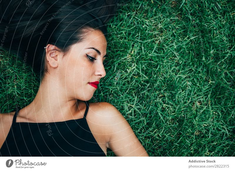 Cheerful brunette woman lying in grass Woman pretty Youth (Young adults) Beautiful Smiling Lie (Untruth) Grass Nature Brunette Attractive Human being