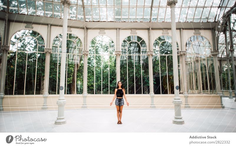 Pretty woman in glass house Woman pretty Youth (Young adults) Beautiful Brunette Stand Glass House (Residential Structure) Garden Park Attractive Human being