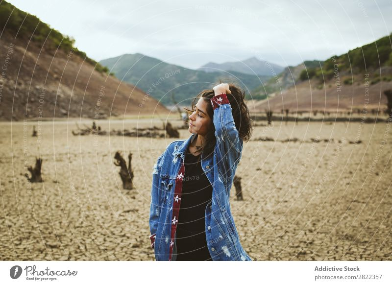 Woman posing in hills Hill Stand Dream Looking away Youth (Young adults) Mountain Vacation & Travel Freedom Action Tourist Adventure Rock Vantage point Hiking
