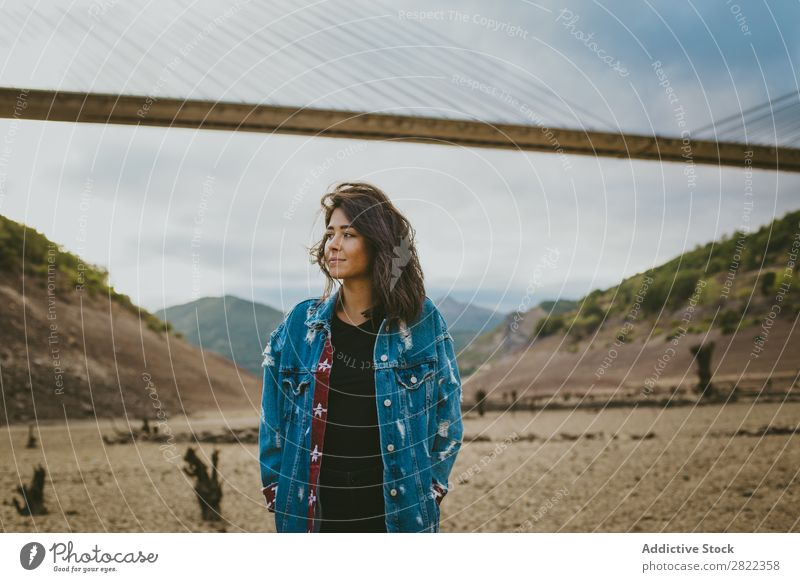 Woman standing at bridge in hills Hill Stand Bridge Construction Dream Looking away Youth (Young adults) Mountain Vacation & Travel Freedom Action Tourist
