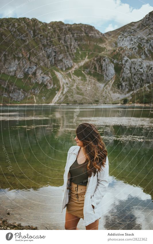 Pretty woman in mountain lake Woman Lake Mountain Stand Hair Adjust Hill Slagheap Water Youth (Young adults) Summer Vacation & Travel Lifestyle Human being Park