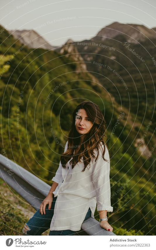 Woman leaning on road fence Roadside Mountain Lean Fence Vacation & Travel Street Summer Girl Youth (Young adults) Human being Adventure Loneliness Nature Trip