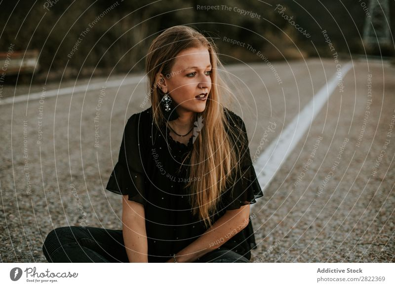 Stylish young woman sitting on roadside Woman Elegant Roadside Nature Posture Self-confident Dream fashionable Gorgeous traveler Provocative Cosmetics roadway