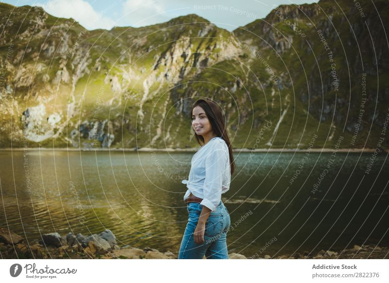 Pretty woman in mountain lake Woman Lake Mountain Smiling Stand Hair Adjust Hill Slagheap Water Youth (Young adults) Summer Vacation & Travel Lifestyle