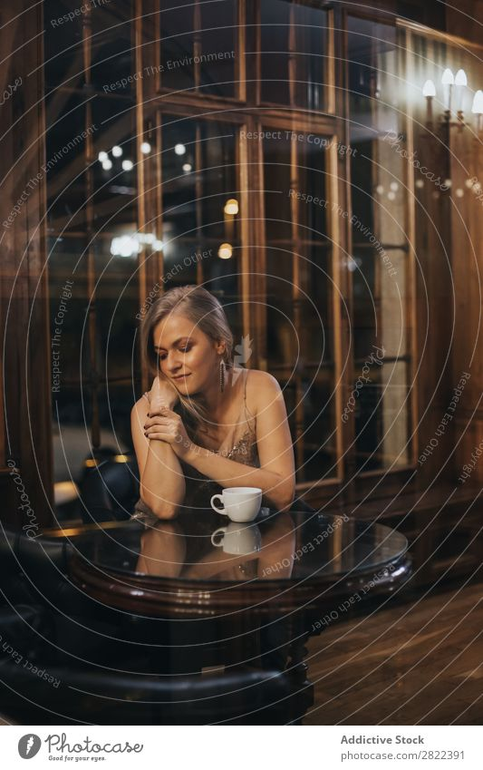 Elegant model posing in bar Woman Bar Dream Luxury Glamor romantic Evening Pensive Youth (Young adults) Style Restaurant Gorgeous Hair and hairstyles To enjoy