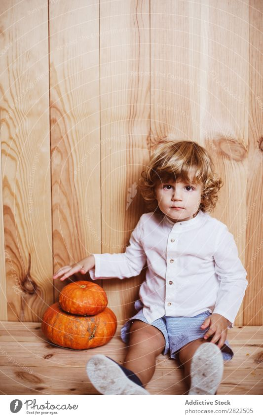 Charming kid posing with pumpkins Child Pumpkin Intellect Fantasy Posture Considerate Vacation & Travel Hallowe'en Autumn human face Infancy Magic Delightful