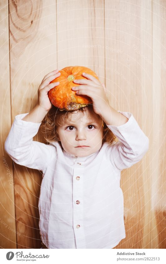Adorable child with pumpkin on head Child Pumpkin Posture Vacation & Travel Hallowe'en Autumn human face Infancy Magic Fantasy decor Interior design Playful