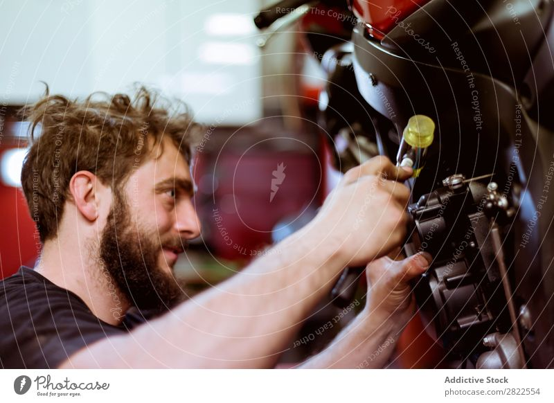 Man working on bike Maintenance Detail Part Employees & Colleagues Motorcycle Workshop Human being