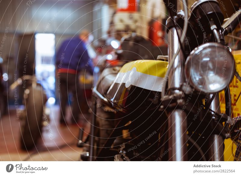 Motorcycle parked in garage Workshop Parked Engines Transport Vehicle Garage custom repair shop Repair Professional Machinery Maintenance