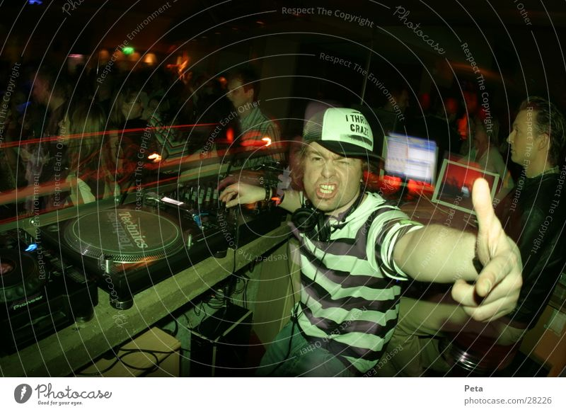 ROCKDJ Disco Music Man Party Party mood Party goer Disc jockey Baseball cap Striped Facial expression Gesture Signal Wild Interior shot Looking into the camera