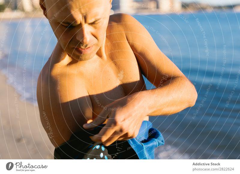 Man wearing wetsuit Wetsuit Diver Wear Dressing Ocean Coast Adventure Vacation & Travel Sports Swimmer (professional sportsman) Beach Summer Water Nature