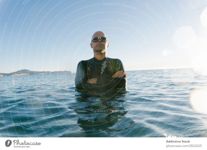 Diver posing in water Man Wetsuit Self-confident Relaxation Ocean Vacation & Travel sportsman Nature Posture Leisure and hobbies hands crossed Dream Swimsuit