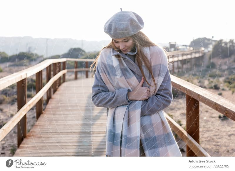 Cheerful woman standing at boardwalk Woman pretty Youth (Young adults) Beautiful Attractive Smiling Corridor Wood Nature Style Beret Human being Coat