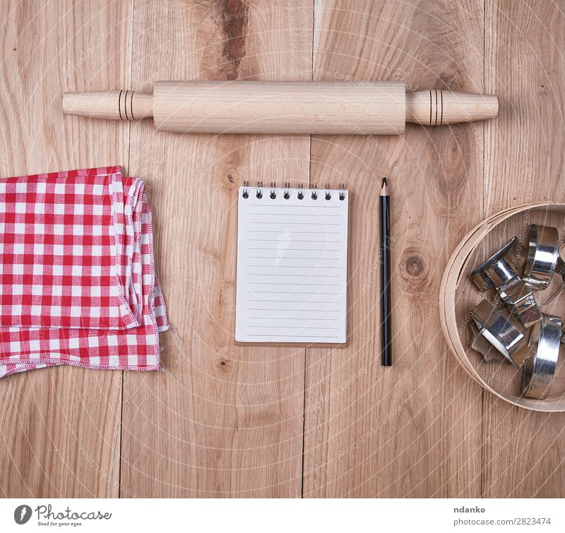 open notebook in a cell, round wooden sieve Cutlery Table Kitchen Sieve Paper Wood Above Brown Yellow Red background Blank cooking Copy Space empty flat food