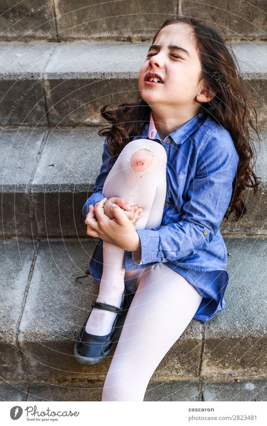 Little girl crying with a wound on her knee Child Human being Summer Blue Girl Healthy Lifestyle Legs Sadness Feminine Sports Emotions Health care Small Playing