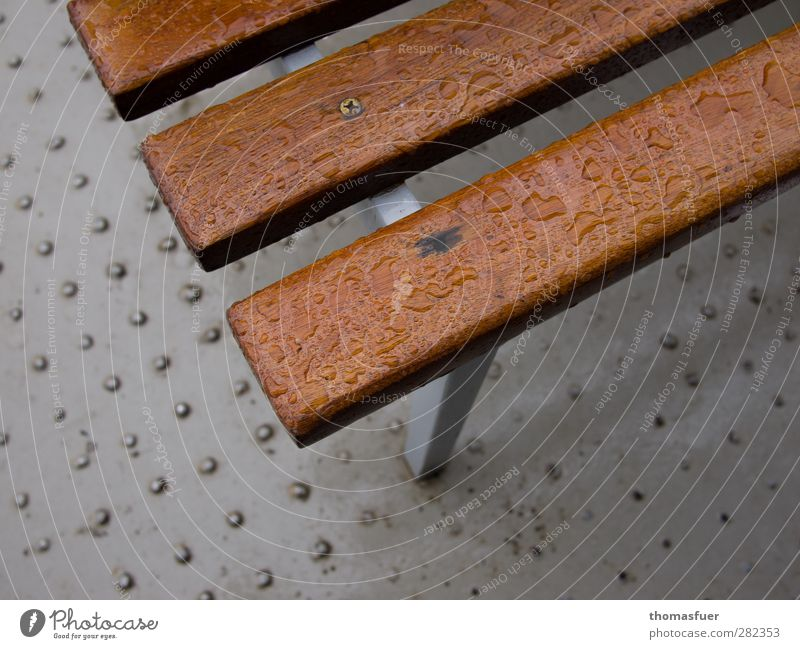 Seating - damp corner Vacation & Travel Birthday Bad weather Rain Alps Wet Brown Gray Bench Metal Floor covering Colour photo Subdued colour Exterior shot