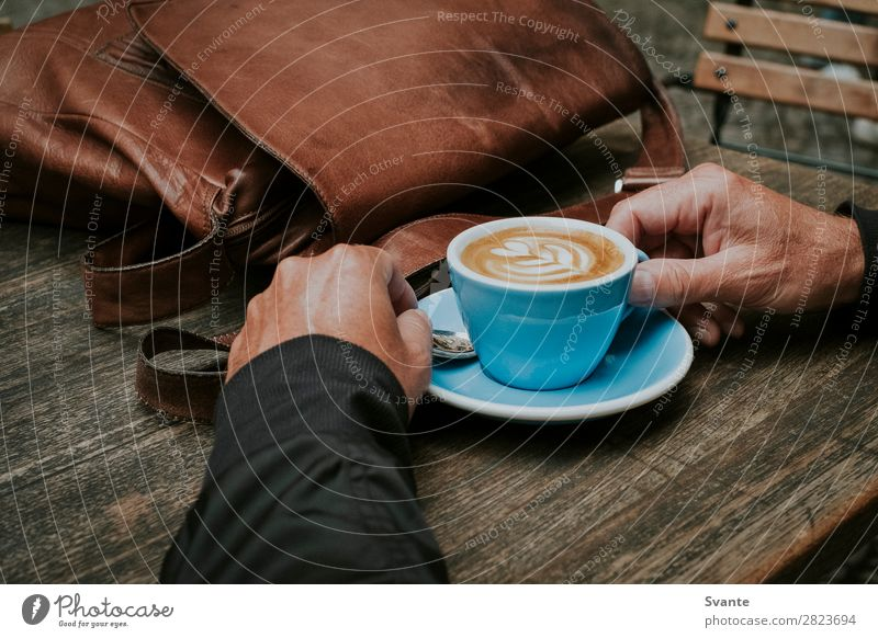 Man holding blue coffee cup on wooden table Beverage Hot drink Coffee Latte macchiato Espresso Lifestyle Elegant Style Human being Hand 1 45 - 60 years Adults