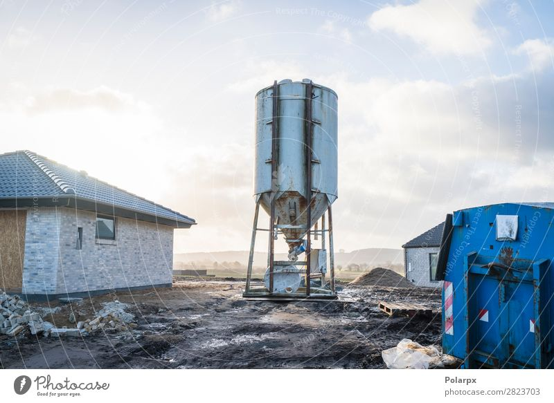 Silo at a construction area with new houses Sky Plant Blue House (Residential Structure) Architecture Business Transport Modern Technology Industry Concrete New
