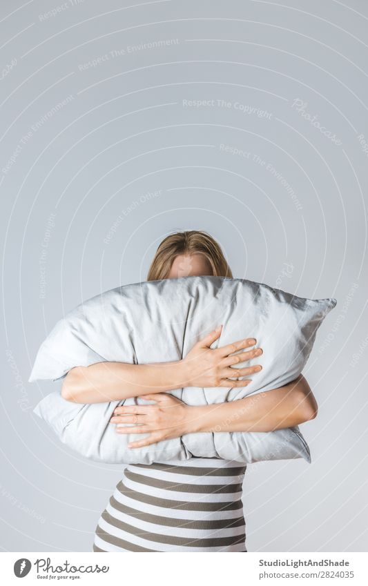 Young woman hugging a gray pillow Woman Human being Colour Beautiful Hand Relaxation Face Lifestyle Adults Natural Gray Modern Blonde Arm Sleep Soft