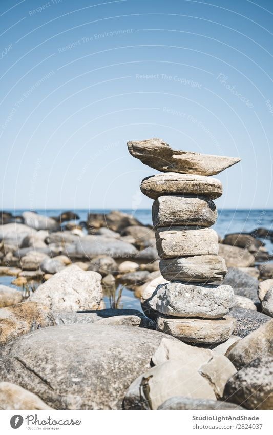 Stack of stones on a rocky beach Beautiful Summer Beach Ocean Island Human being Nature Landscape Sky Rock Coast Baltic Sea Building Souvenir Stone Maritime