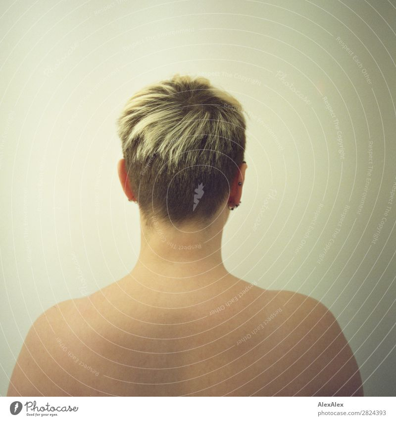 Portrait of a young woman from behind Exotic Beautiful Young woman Youth (Young adults) Head Shoulder 18 - 30 years Adults Jewellery Blonde Short-haired Observe