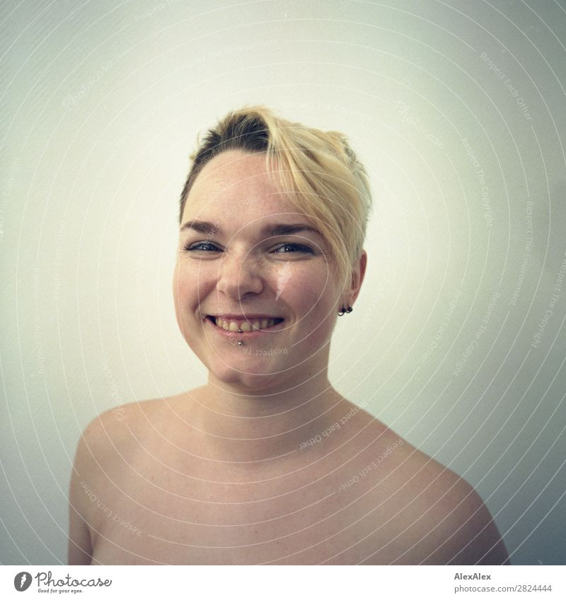 young woman with freckles smiles cheeky on analogue picture Joy pretty Skin Face Room Young woman Youth (Young adults) 18 - 30 years Adults Naked Piercing