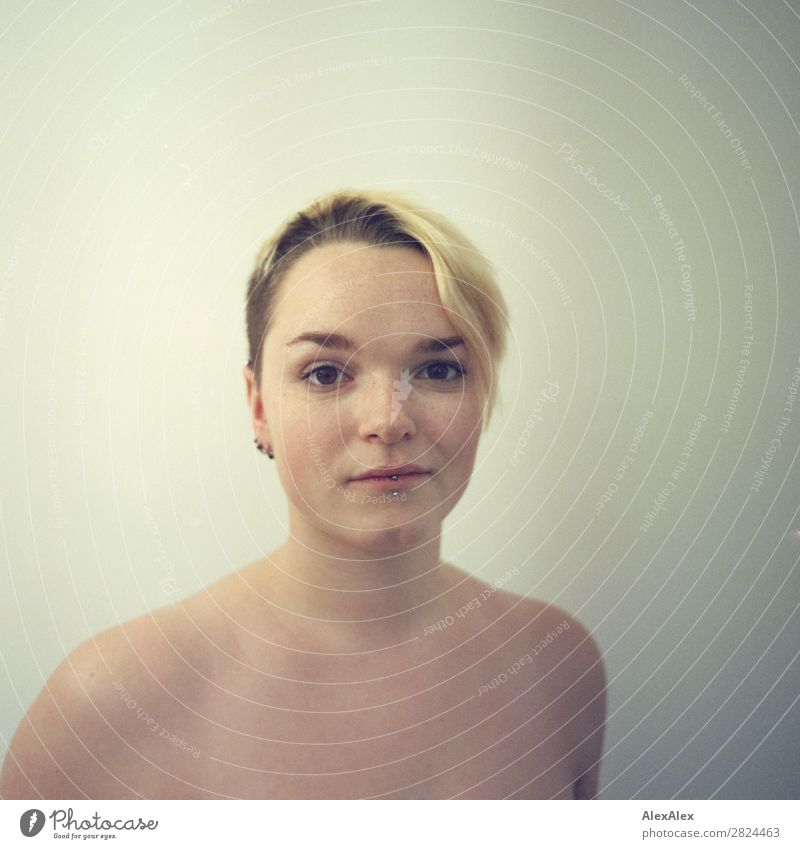 Portrait of a young woman with freckles Joy Beautiful Well-being Young woman Youth (Young adults) Face 18 - 30 years Adults Blonde Short-haired Freckles Observe