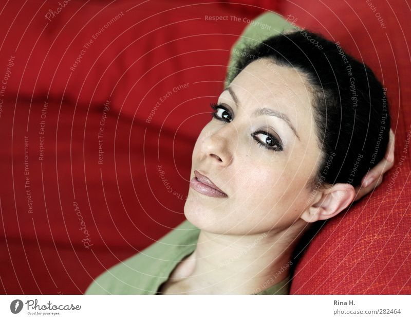 relaxation Calm Sofa Woman Adults 1 Human being 30 - 45 years Hair and hairstyles Black-haired Brunette Relaxation Looking Sit Beautiful Feminine Red