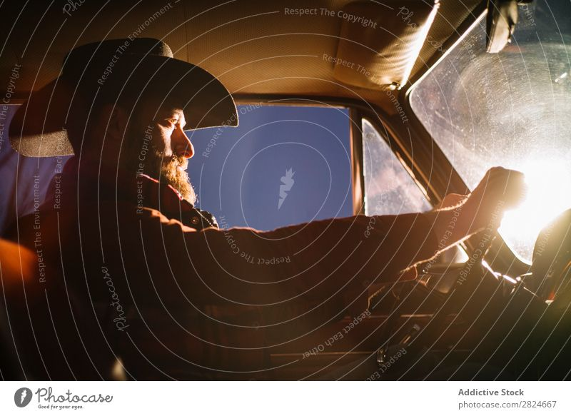 Stylish man driving old timer at night Man Car Vintage Retro White Hat headlight Evening Night Vehicle Classic Old Adults Vacation & Travel Human being