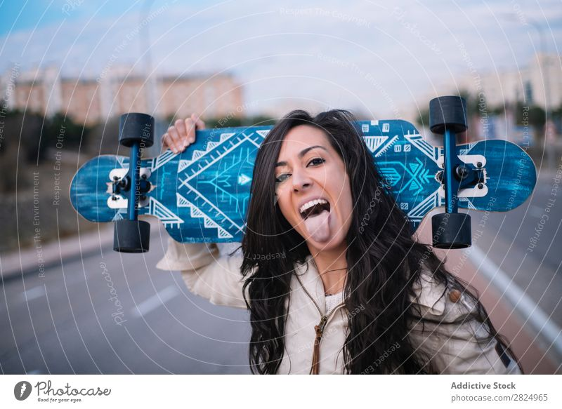 Brunette girl with longboard in the street Caucasian Town Board Cool (slang) Hip & trendy Woman 1 Coast Leisure and hobbies Girl Exterior shot Street Lifestyle