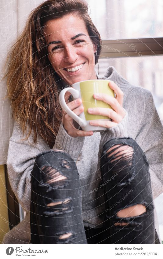 Cheerful woman relaxing with cup Woman Home Relaxation Lifestyle Cup Mug Drinking Hot Smiling Coffee Tea Beautiful Room Human being Easygoing Adults