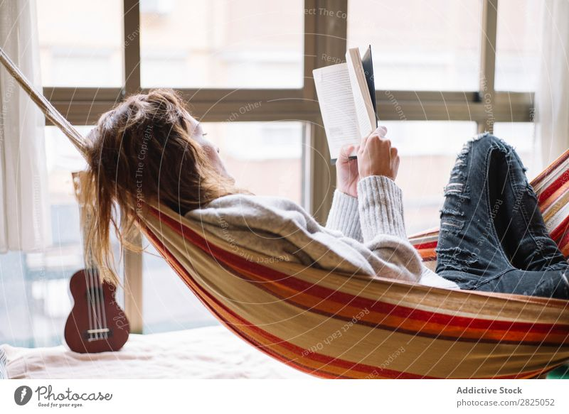 Woman in hammock relaxing with book Home Relaxation Lie (Untruth) Hammock Reading Book Literature Lifestyle Beautiful Room Human being Easygoing Adults