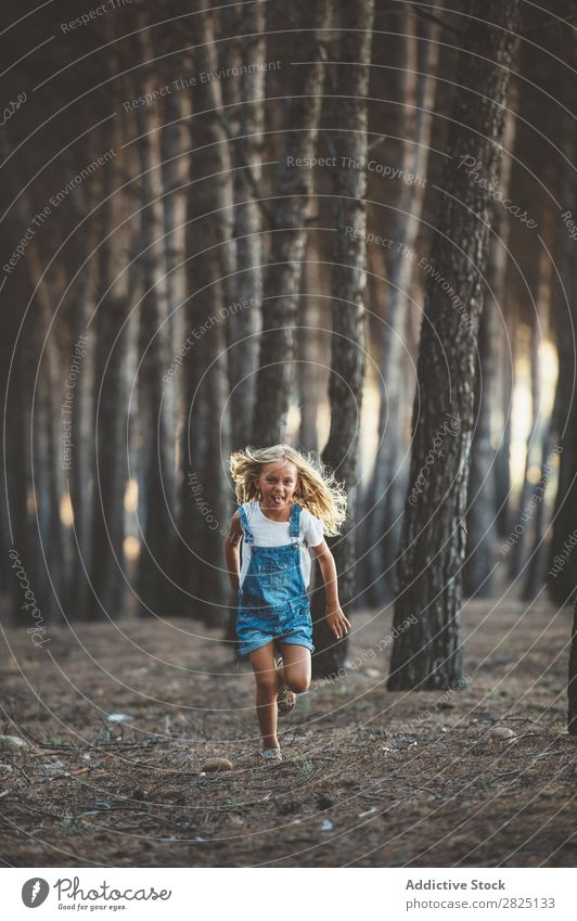 Happy child running in forest Girl Happiness Forest Action Running Freedom grimacing showing tongue Recklessness in motion Leisure and hobbies Nature Innocent
