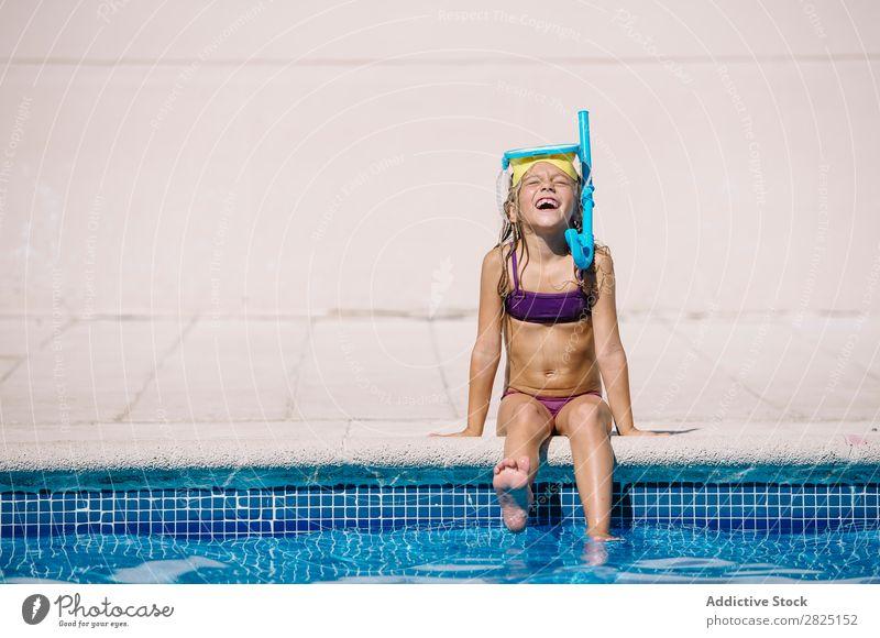 Kid playing in pool Child poolside Splashing Playing having fun Vacation & Travel Summer Cheerful Water Leisure and hobbies Joy splashes Playful Action
