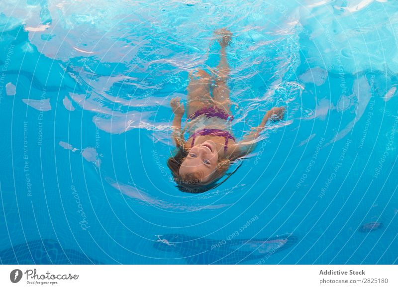 Child swimming in pool Swimming pool Floating human face Infancy Summer Vacation & Travel Water Girl Relaxation Action Swimmer (professional sportsman) Healthy