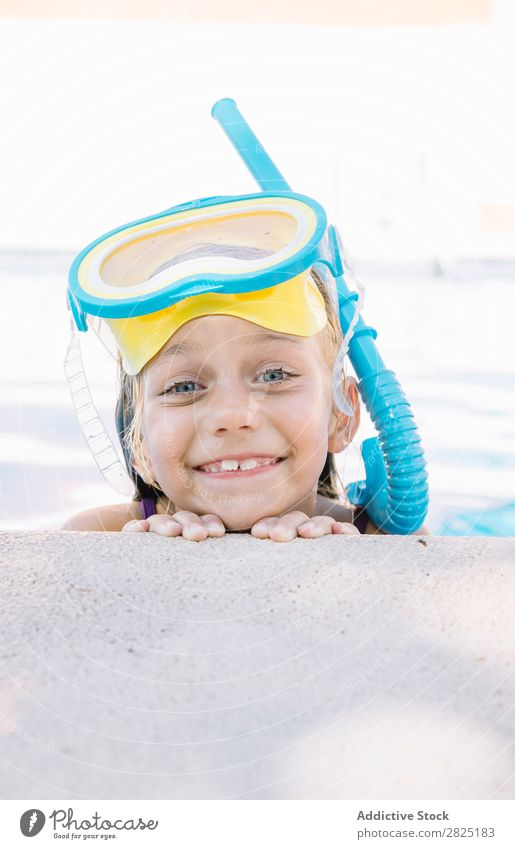 Kid in snorkel mask posing on poolside Child Swimming pool Mask Relaxation Vacation & Travel Posture human face Leisure and hobbies Dive Contentment Cheerful
