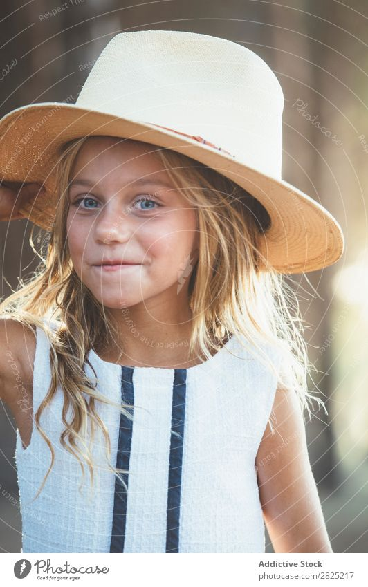Smiling kid in hat outside Child Cheerful Playful Portrait photograph Happiness Posture Style Hat Self-confident Cowboy Laughter Girl Delightful Summer