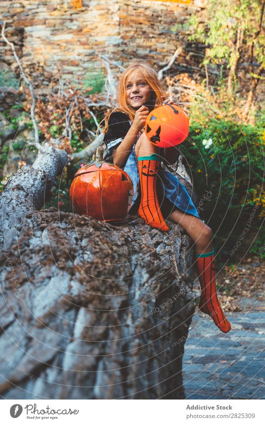 Expressive kid in costume posing on tree Girl Costume Nature Hallowe'en Playful Posture Feasts & Celebrations Outstretched Expression Tree trunk Scream Clothing