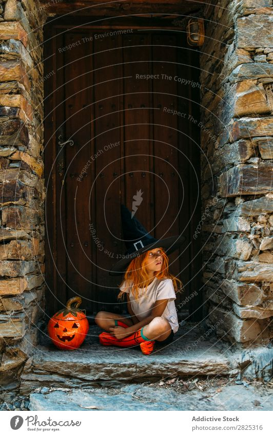 Adorable girl posing on porch Girl Hallowe'en pretend terrify Posture Portrait photograph Cheerful House (Residential Structure) Costume Feasts & Celebrations