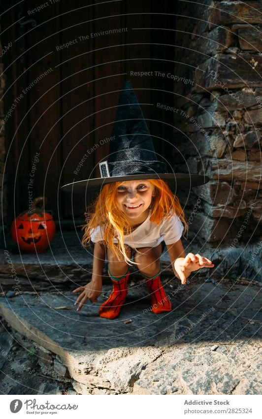 Adorable girl posing playfully Girl Hallowe'en pretend terrify Posture Portrait photograph Cheerful House (Residential Structure) Costume Feasts & Celebrations