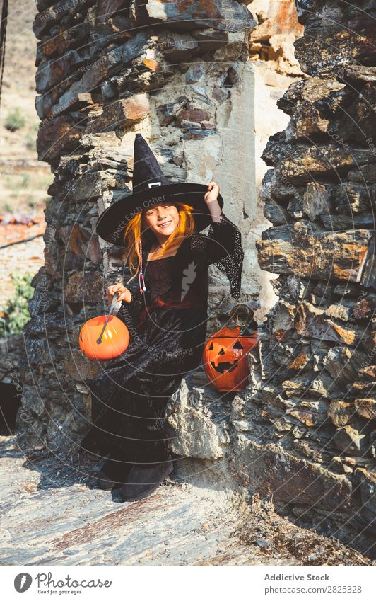 Content girl in Halloween costume at street Girl Costume Witch Hallowe'en Playful Feasts & Celebrations Tradition Expression Intellect Guest Street Infancy