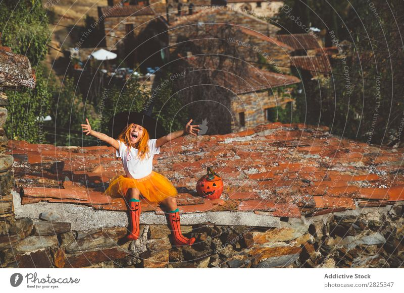 Girl in costume posing on roof Costume Hallowe'en Playful rooftop Feasts & Celebrations Posture Intellect Tradition Expression Seasons Guest Street Infancy