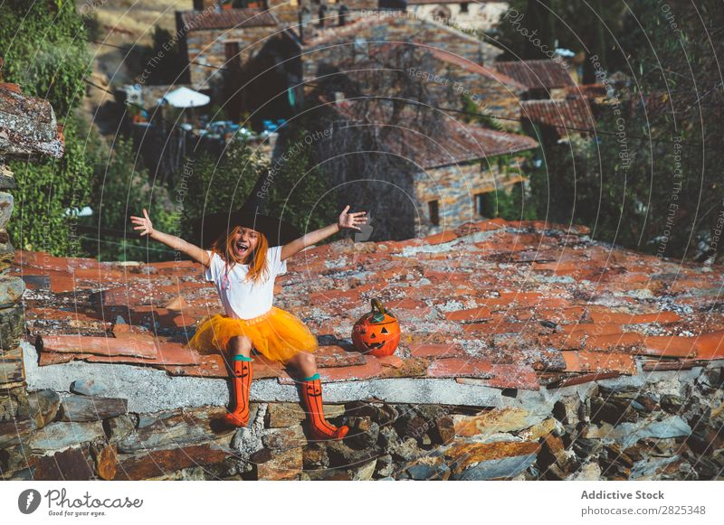 Girl in costume posing on roof Costume Hallowe'en Playful Feasts & Celebrations Posture Intellect Tradition