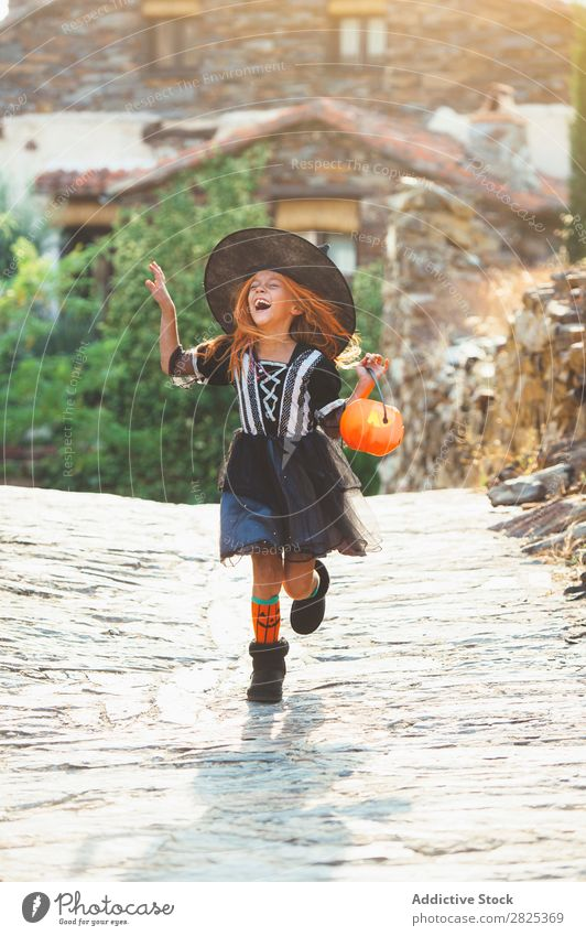 Laughing girl in costume at street Girl Costume Hallowe'en Playful Emotions Feasts & Celebrations Intellect Scream