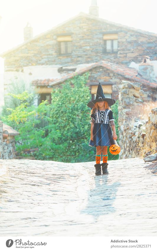 Little girl in witch costume Girl Hallowe'en Costume Witch Holiday season Guest Posture Tradition Carnival Earnest Occasion Child pretend Vacation & Travel