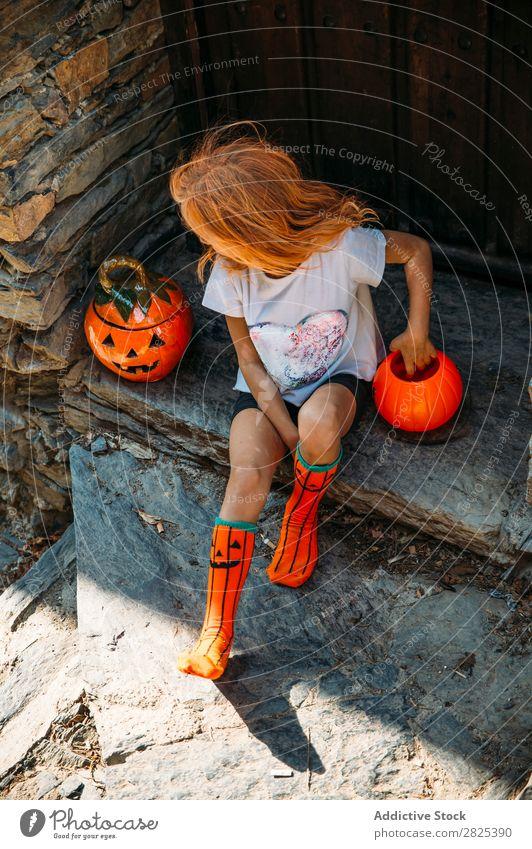 Charming sitting on porch Girl Veranda Hallowe'en Pumpkin Guest Tradition decor Design Vacation & Travel Autumn Festival Child Infancy Happiness
