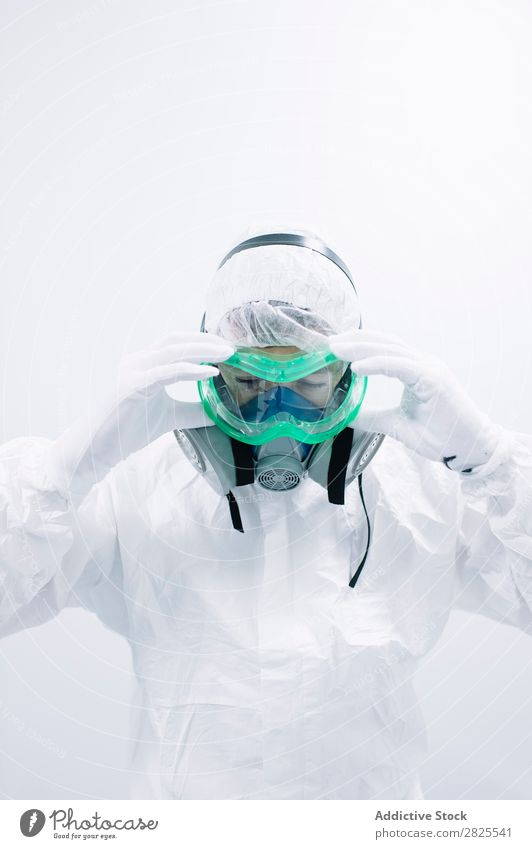 Scientist putting on protective mask Laboratory Research Chemistry Dressing Mask Protective Cooking experiment Science & Research Medication scientific